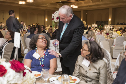 Mark stops to chat with Valesca Adams, a 40-year employee who was honored recently at the annual Employee Recognition Celebration.