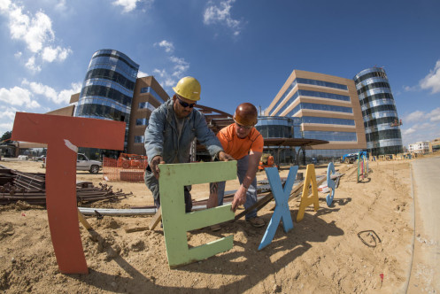 2k16-0098-AK4_3684 Woodlands Construction Update  2-19-16 Workers install mock-up lettering