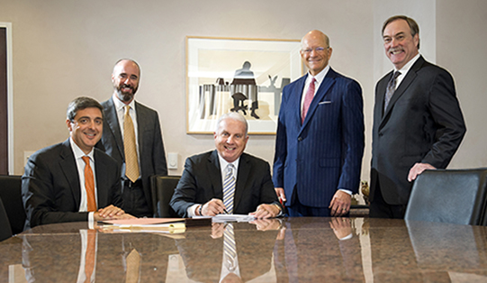Texas Children's President and CEO Mark Wallace signs closing documents for the purchase of the Baylor Clinic Building and O'Quinn Medical Tower. He is joined, from left, by outside counsel Darren Inoff; Texas Children's Vice President and General Counsel Lance Lightfoot; Jones Lang LaSalle President Dan Bellow; and Texas Children's Director of Real Estate Services David Perryman.
